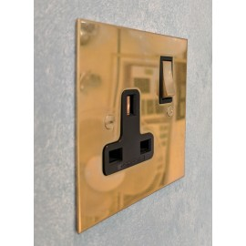 1 Gang 13A Switched Socket in Unlacquered Brass Plate and Rocker Switch with Plastic Insert